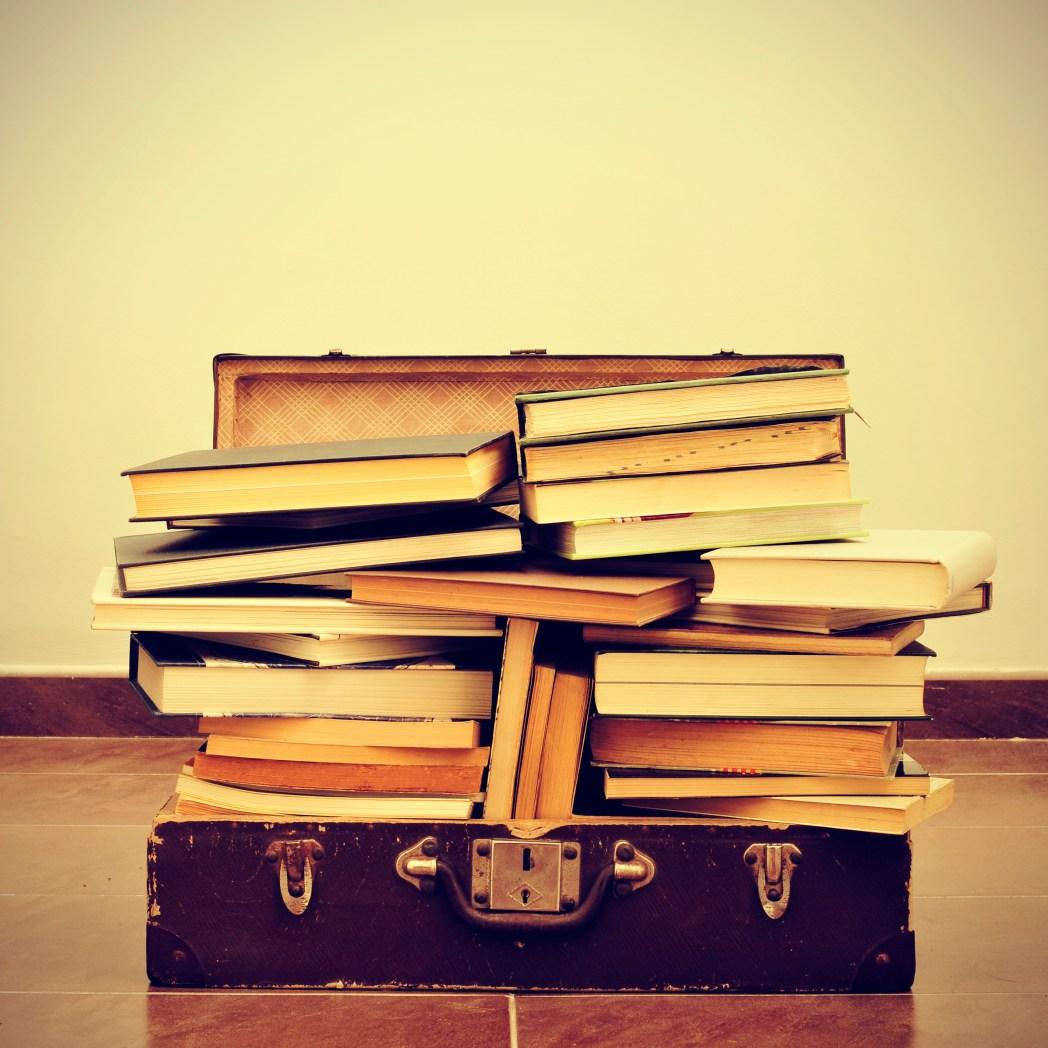 Gepäck-Gewicht reduzieren: Bücher Koffer Urlaub